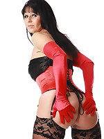 Desyra has a sexy red corset and a combination with black stockings